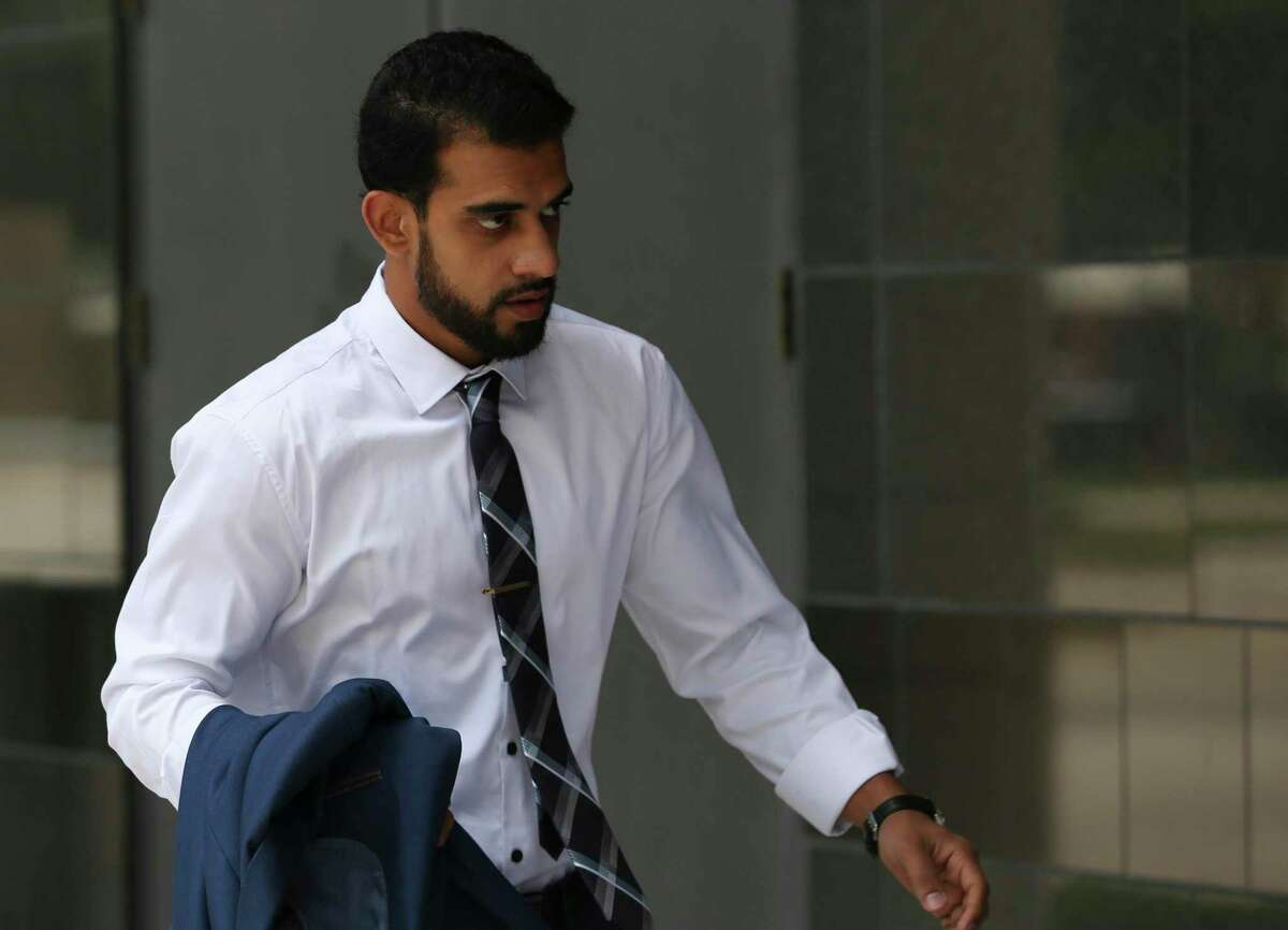 Asher Abid Khan, of Spring, walks toward the U.S. District Court for his first sentencing before a federal court judge on Monday, June 25, 2018, in Houston. Khan was a University of Houston student who admitted he plotted to join the jihadist fight in Syria.