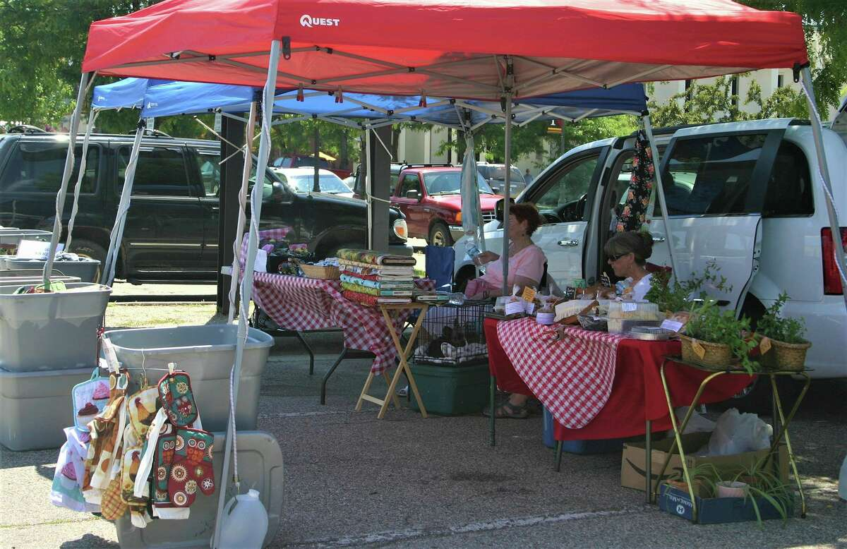 Vendors line the parking lot outside City Hall during last year'sBig Rapids Farmers' Market. (Pioneer files/Cathie Crew)