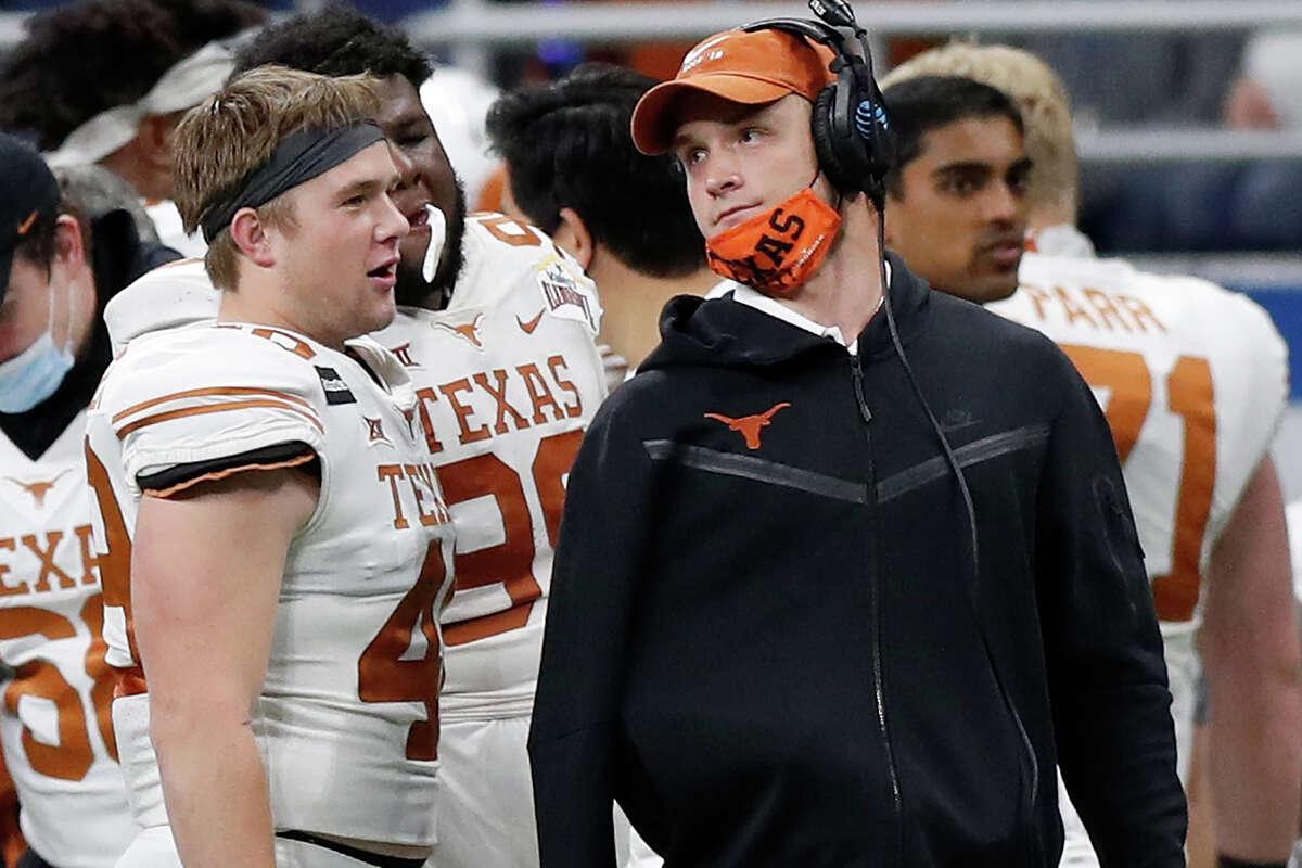 Jake Ehlinger, left, speaks with older brother Sam Ehlinger during Texas' Alamo Bowl victory over Colorado in December 2020. Jake Ehlinger was found dead by Austin police Thursday.