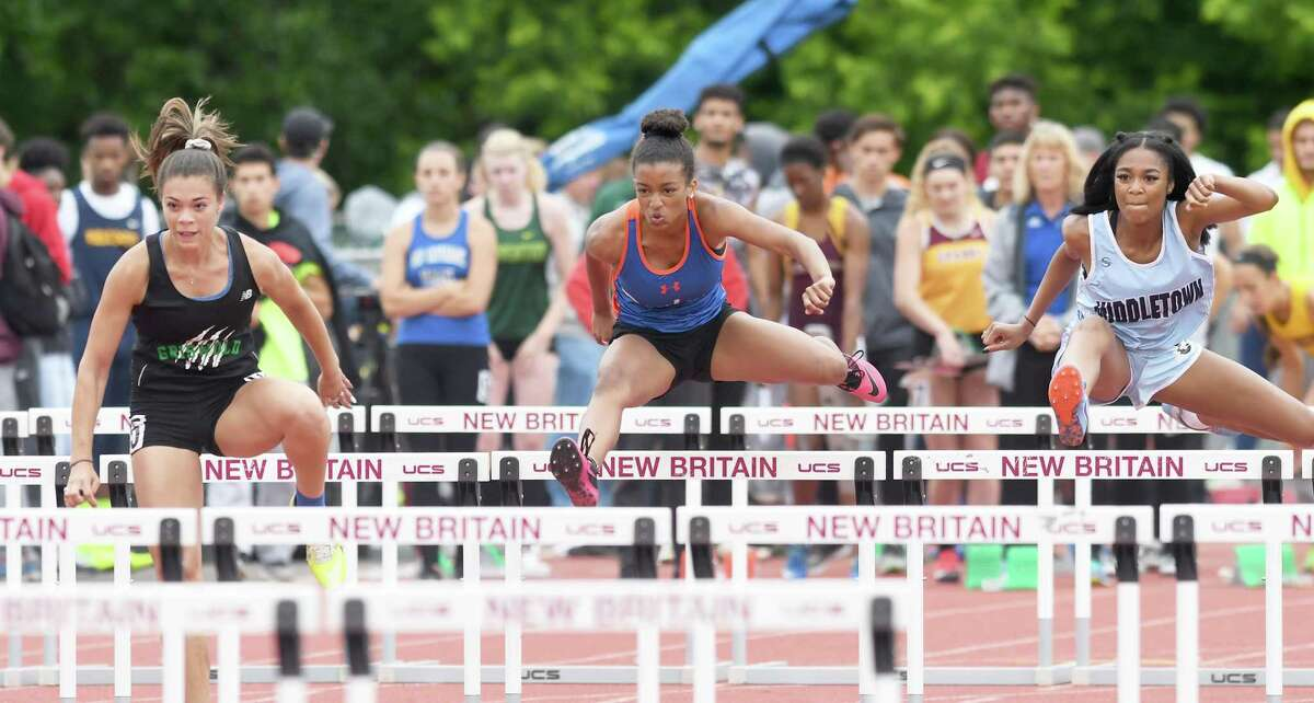 Athletes compete in the 2018 outdoor track State Open at Willow Brook Park in New Britain. What the State Open looks like this year remains to be seen.