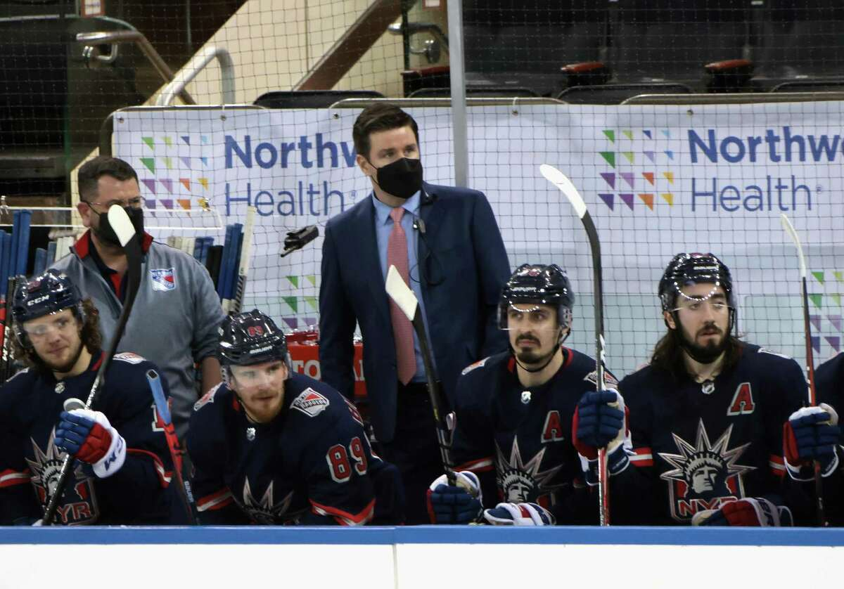 New York Rangers Associate General Manager Chris Drury works the bench during the game against the Philadelphia Flyers at Madison Square Garden on March 17 in New York. Due to the NHL COVID-10 protocol, the Rangers coaching staff was not available for the game.