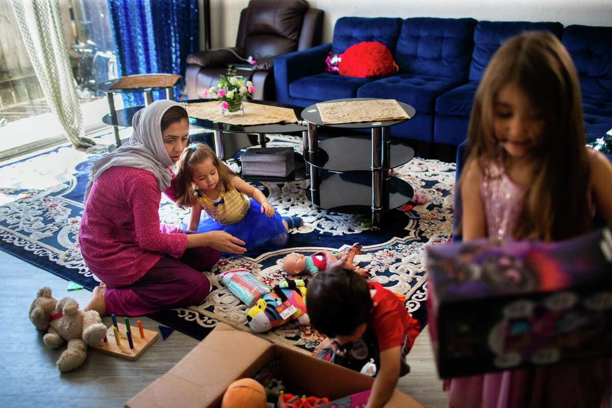 Freshta Amiri, 32, plays with her children Liza Amiri, 2, Maisam Amiri, 4, and Mitra Amiri at their home. Amiri, who immigrated to the U.S. from Afghanistan six years ago, is a full-time stay-at-home mother and a student.