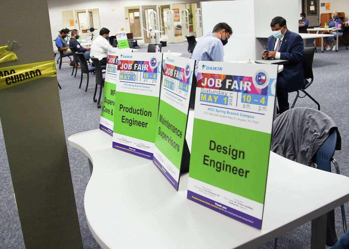 People interview for jobs during a Daikin job fair at Houston Community College in Spring Branch on Saturday, May 1, 2021. While the broader economy is recovering, the pandemic is expected to have a long-lasting impact on many Texans' personal finances.