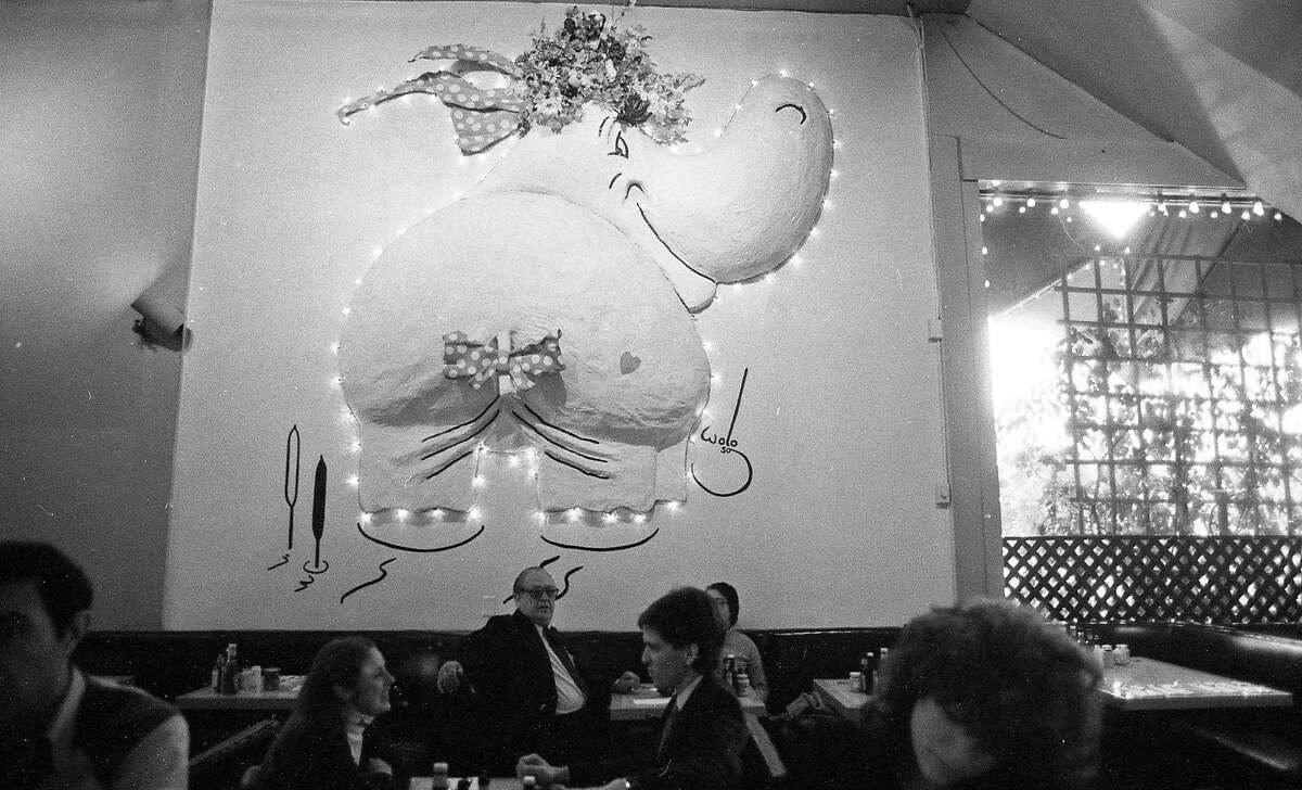 The Hippo Burger restaurant on Van Ness Avenue in San Francisco on November 23, 1983 with a hippo sculpture on the wall.  The hippo was a popular place to eat from the 1950s to 1980s.