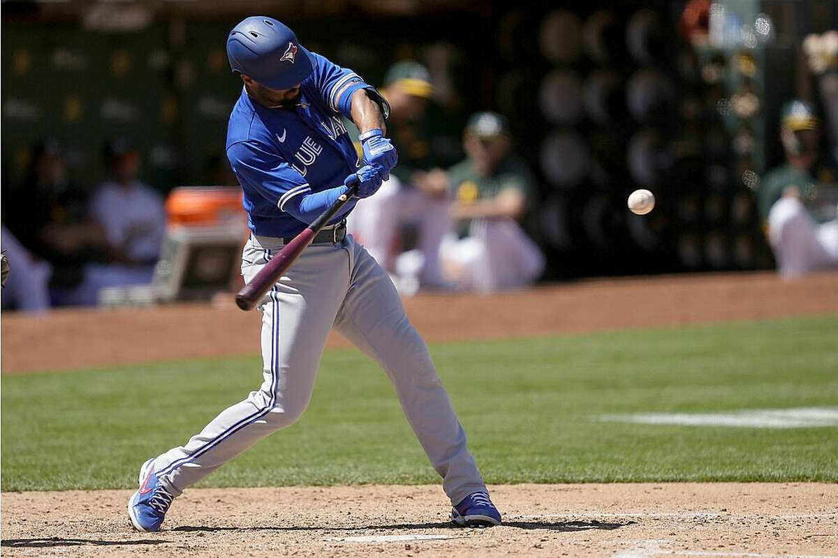 Marcus Semien started two Blue Jays rallies with singles at the Coliseum on Thursday, including this one in the sixth.