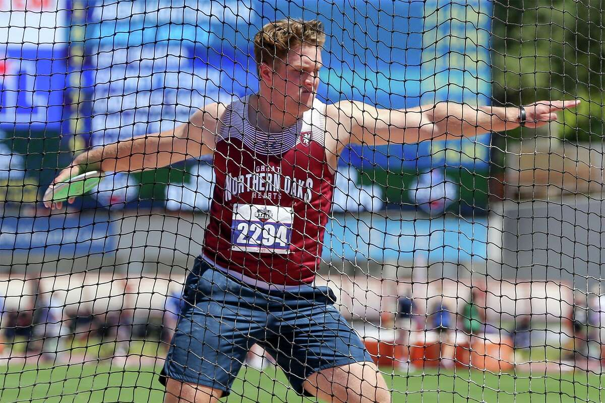 Great Hearts Northern Oaks' John Hanson winds up for his final toss in the 3A boys discus throw during the UIL state track and field championships at Mike A. Myers Stadium in Austin on Thursday, May 6, 2021. Hanson won the event with a throw of 174-6.