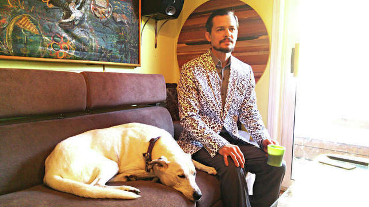 Artist Michael Snider, who will be featured in Jacoby Arts Centers' Emerging Artists Showcase, at his Alton home.