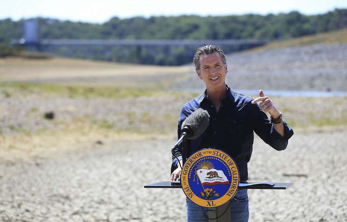 California Gov. Gavin Newsom speaks at a news conference in the parched basin of Lake Mendocino in Ukiah, Calif., Wednesday, April 21, 2021, where he announced he would proclaim a drought emergency for Mendocino and Sonoma counties. (Kent Porter/The Press Democrat via AP)