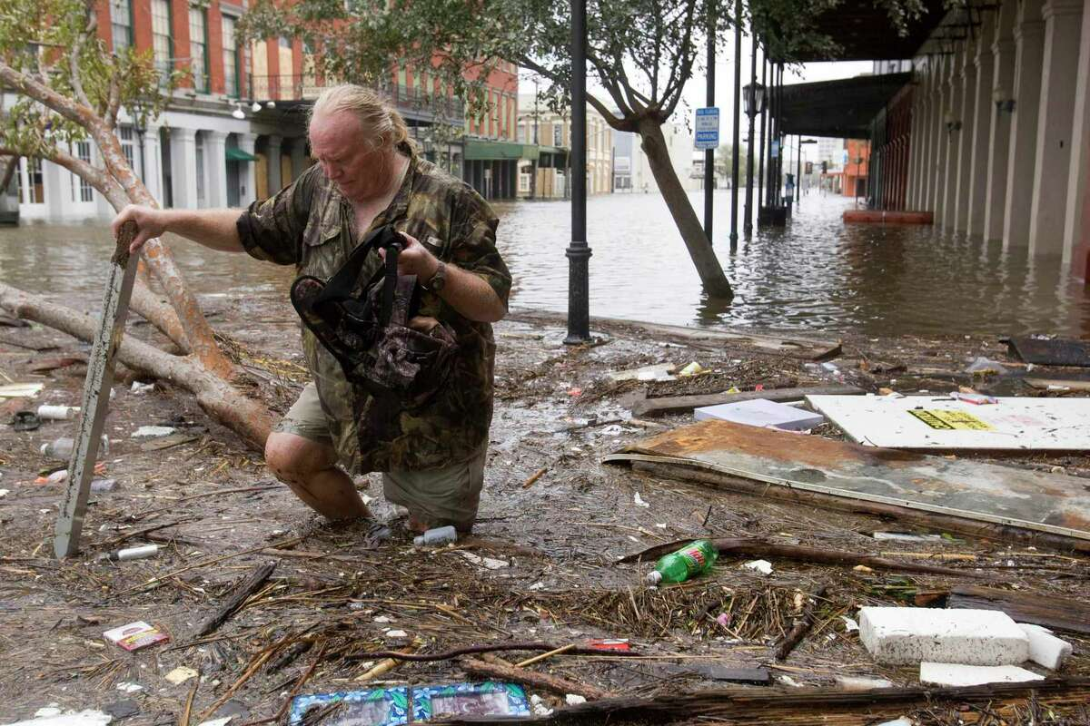 Tom LeCroy walks through debris strewn in The Strand that suffered flooding in the aftermath of Hurricane Ike Saturday, Sept. 13, 2008, in Galveston, Texas. LeCroy's, who rode out the storm in The Strand, restaurant suffered major flood damage.