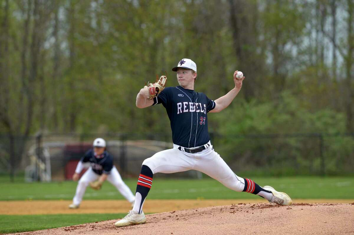 New Fairfield's Braden Quinn (33) pitches in the boys baseball game between Newtown and New Fairfield high schools on Monday at New Fairfield High School.