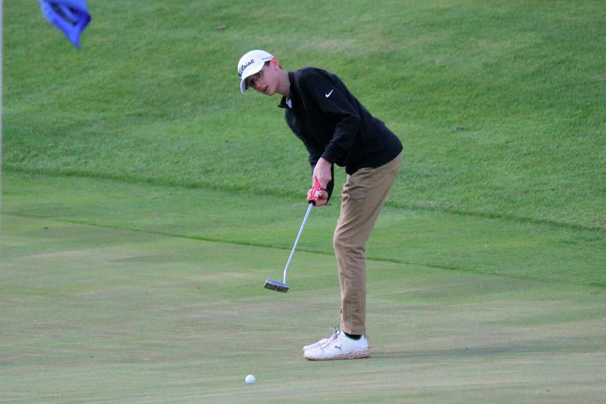Benzie Central's Andrew Warsecke watches his putt on May 6. (Robert Myers/Record Patriot)