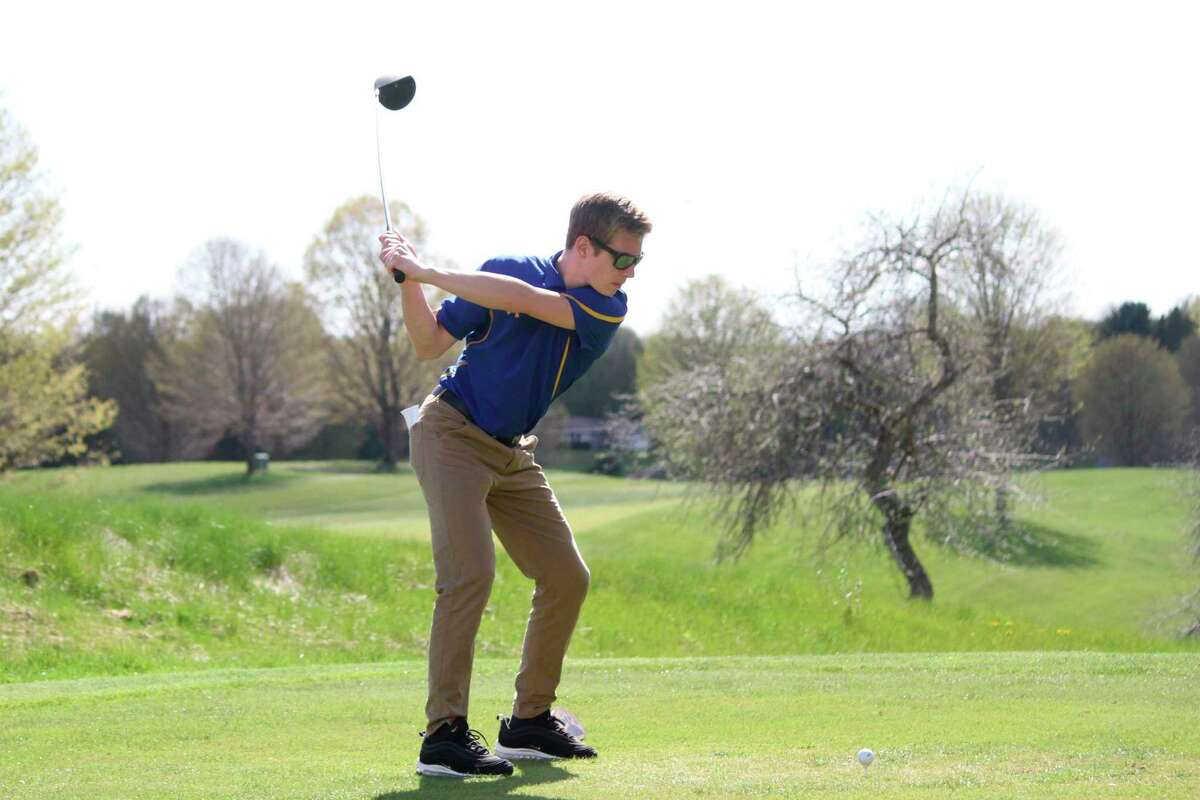 Sawyer Christensen tees off for Onekama on May 6 at Bear Lake Highlands. (Robert Myers/News Advocate)