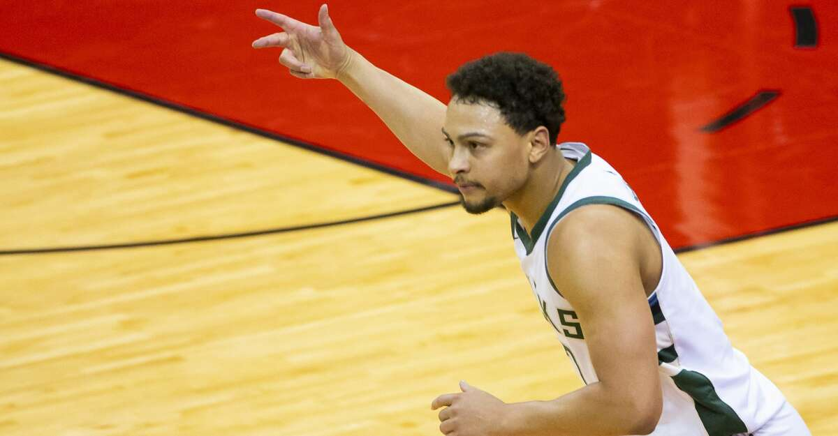 Milwaukee Bucks guard Bryn Forbes (7) celebrates after hitting another 3-point shot during the second quarter of an NBA game between the Houston Rockets and Milwaukee Bucks on Thursday, April 29, 2021, at Toyota Center in Houston.