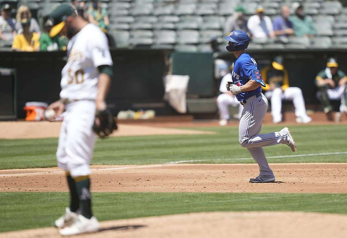 OAKLAND, CALIFORNIA - MAY 06: Randal Grichuk #15 of the Toronto Blue Jays trots around the bases after hitting a three-run home run off of Mike Fiers #50 of the Oakland Athletics in the third inning at RingCentral Coliseum on May 06, 2021 in Oakland, California. (Photo by Thearon W. Henderson/Getty Images)
