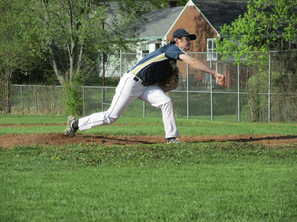 Wolcott Tech's Tyler Brzezicki mopped up the final two innings in a Wildcat win over Gilbert while adding firepower at bat Thursday afternoon at Wolcott Tech High School.