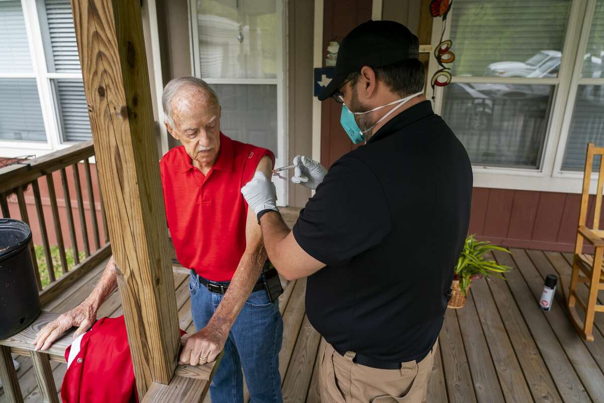 Chambers County paramedic Danny Burke administers a dose of the Moderna COVID-19 vaccine to Leon Klutts, 87, outside of Klutts' home, Tuesday, April 6, 2021, in Winnie, TX. The Chambers County ambulance service has been administering vaccines to people in their homes, including Klutts, who was receiving the second dose of the vaccine.
