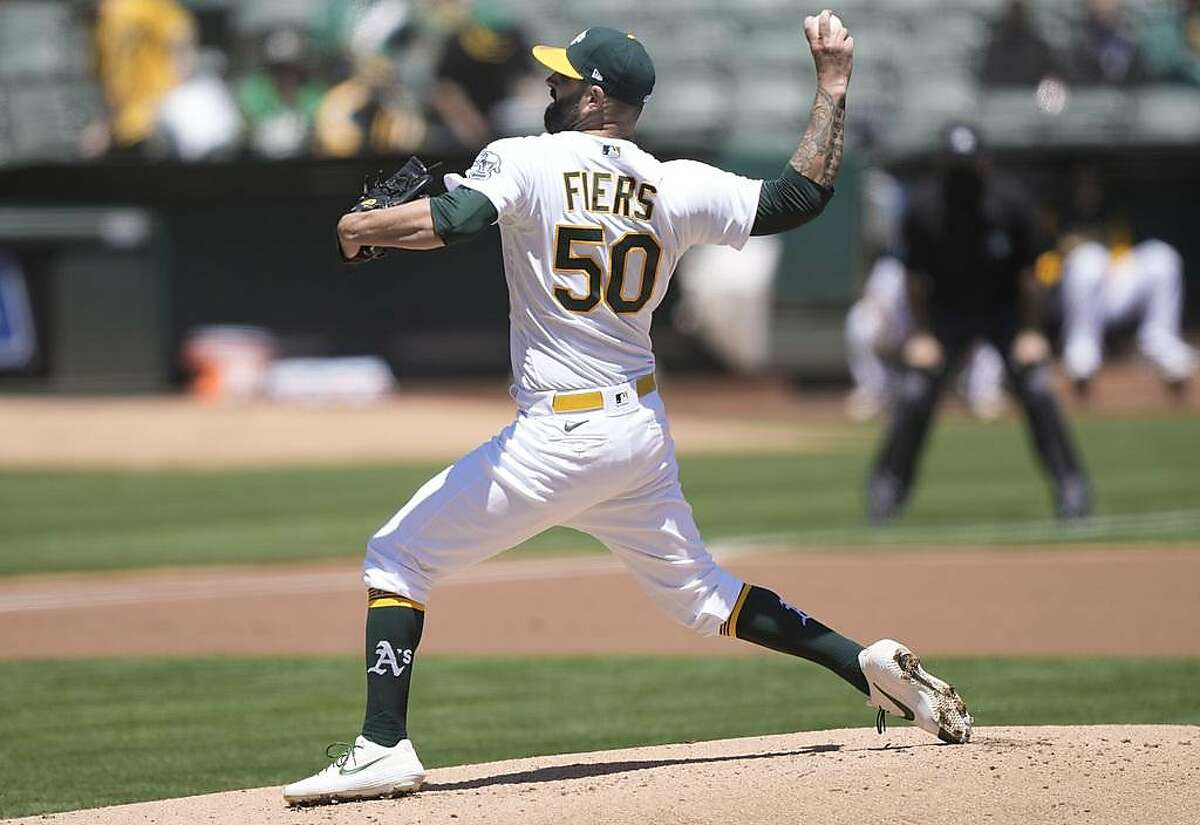 OAKLAND, CALIFORNIA - MAY 06: Mike Fiers #50 of the Oakland Athletics pitches against the Toronto Blue Jays in the first inning at RingCentral Coliseum on May 06, 2021 in Oakland, California. (Photo by Thearon W. Henderson/Getty Images)