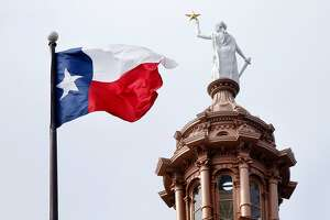 The Texas flag flies over the state Capitol in Austin in 2019. (Tom Fox/The Dallas Morning News/TNS)