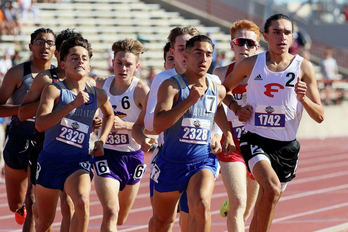 Fredericksburg's Khristian Torres, right, runs in the lead midway through the 4A boys 800-meter run in the UIL state track and field championships at Mike A. Myers Stadium in Austin on Thursday, May 6, 2021. Torres finished third with a time of 1:57.39.