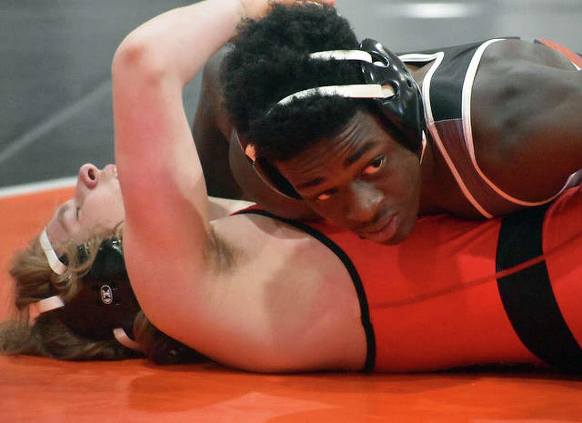 Edwardsville's Jorden Johnson pins his Granite City opponent during the 152-pound match against on Thursday inside the Jon Davis Wrestling Center.