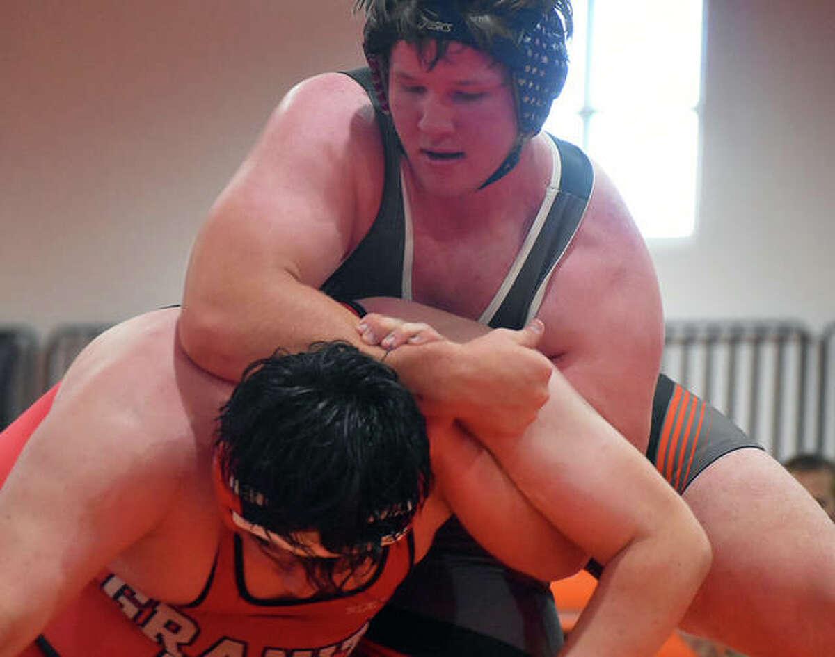 Edwardsville's Mason Taylor, top, in control during his 285-pound match against Granite City on Thursday inside the Jon Davis Wrestling Center.