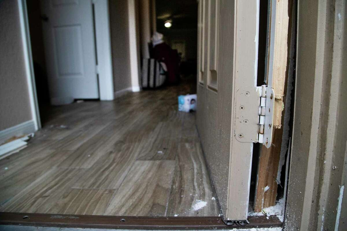 Entrance of unlicensed group home with door broken, Wednesday, Sept. 23, 2020, in Houston. More than 30 people were being housed there without adequate food or medication.