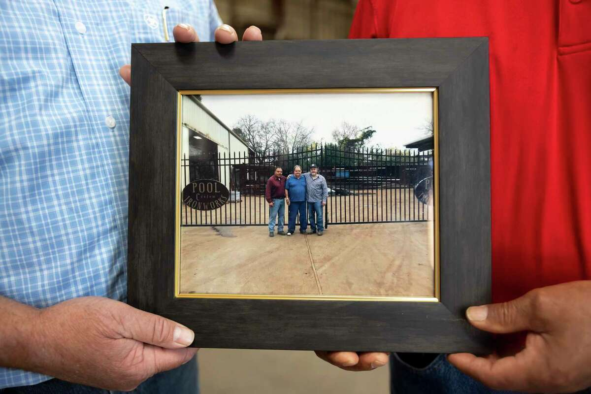 A photo of current co-owners, Dusty Adams, right and Freddy Betancourt, left with past owner, Mr. Pool, is seen at Pool Custom Ironworks, Wednesday, May 5, 2021, in Conroe. The company will be celebrating it's 50th anniversary of opening this Saturday.
