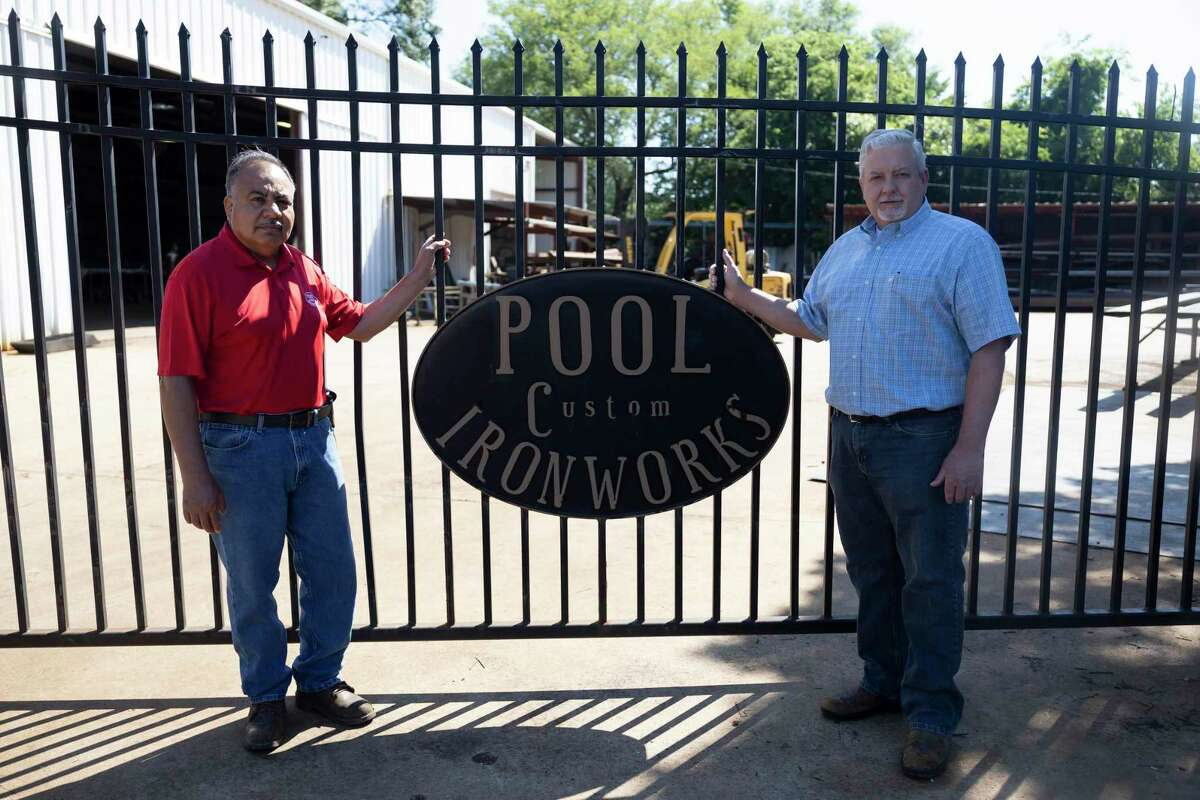 Dusty Adams, right and Freddy Betancourt, co-owners of Pool Custom Ironworks, pose for a portrait, Wednesday, May 5, 2021, in Conroe. The company will be celebrating it's 50th anniversary of opening this Saturday.