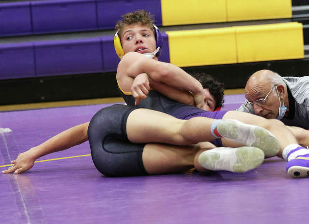 CM's Caleb Tyus (top) looks back to get instructions from his coach while working over Roxana's Bryan Rodriguez in a 138-pount match Thursday in Bethalto. Tyus won by pin.
