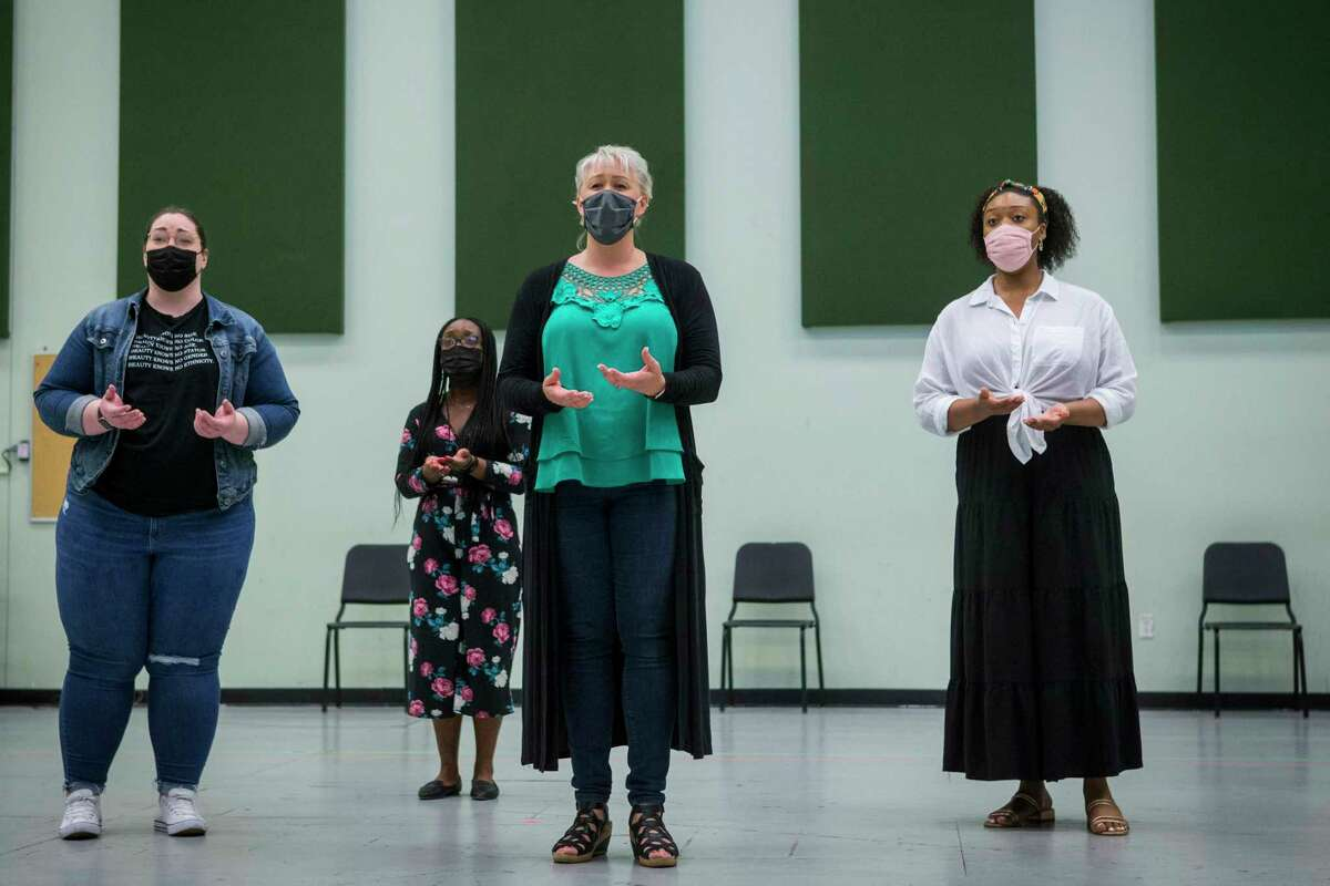 Lindsay Kate Brown, left, Raven McMillon, Katie Van Kooten and Zoie Reams perform during a rehearsal of