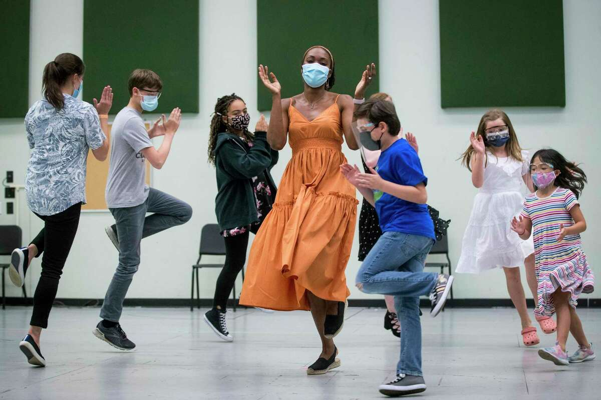 Jeanine De Bique as Maria performs with the artists playing the Von Trapp children during a rehearsal of