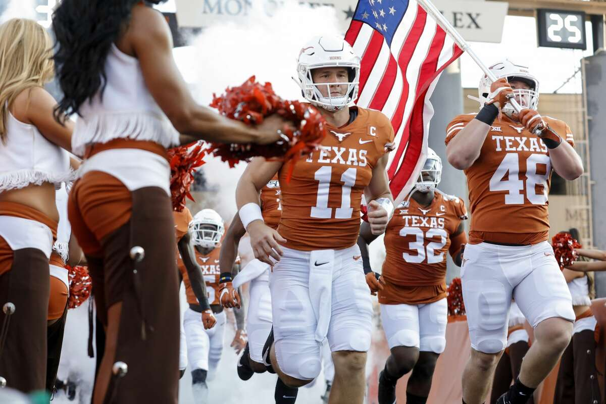 AUSTIN, TX - AUGUST 31: Sam Ehlinger #11 of the Texas Longhorns and Jake Ehlinger #48 run onto the field before the game against the Louisiana Tech Bulldogs at Darrell K Royal-Texas Memorial Stadium on August 31, 2019 in Austin, Texas. (Photo by Tim Warner/Getty Images)