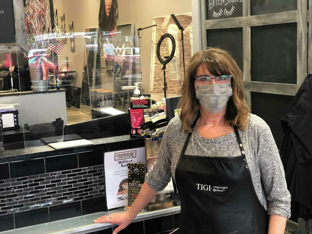 Leeanne Shade, owner of Choices Hair Studio in Delaware Plaza in Delmar. Shade fears the town's plan to reduce lanes on Delaware Avenue and the long construction project that would re-route traffic would disrupt her business, forcing her customers to go elsewhere.