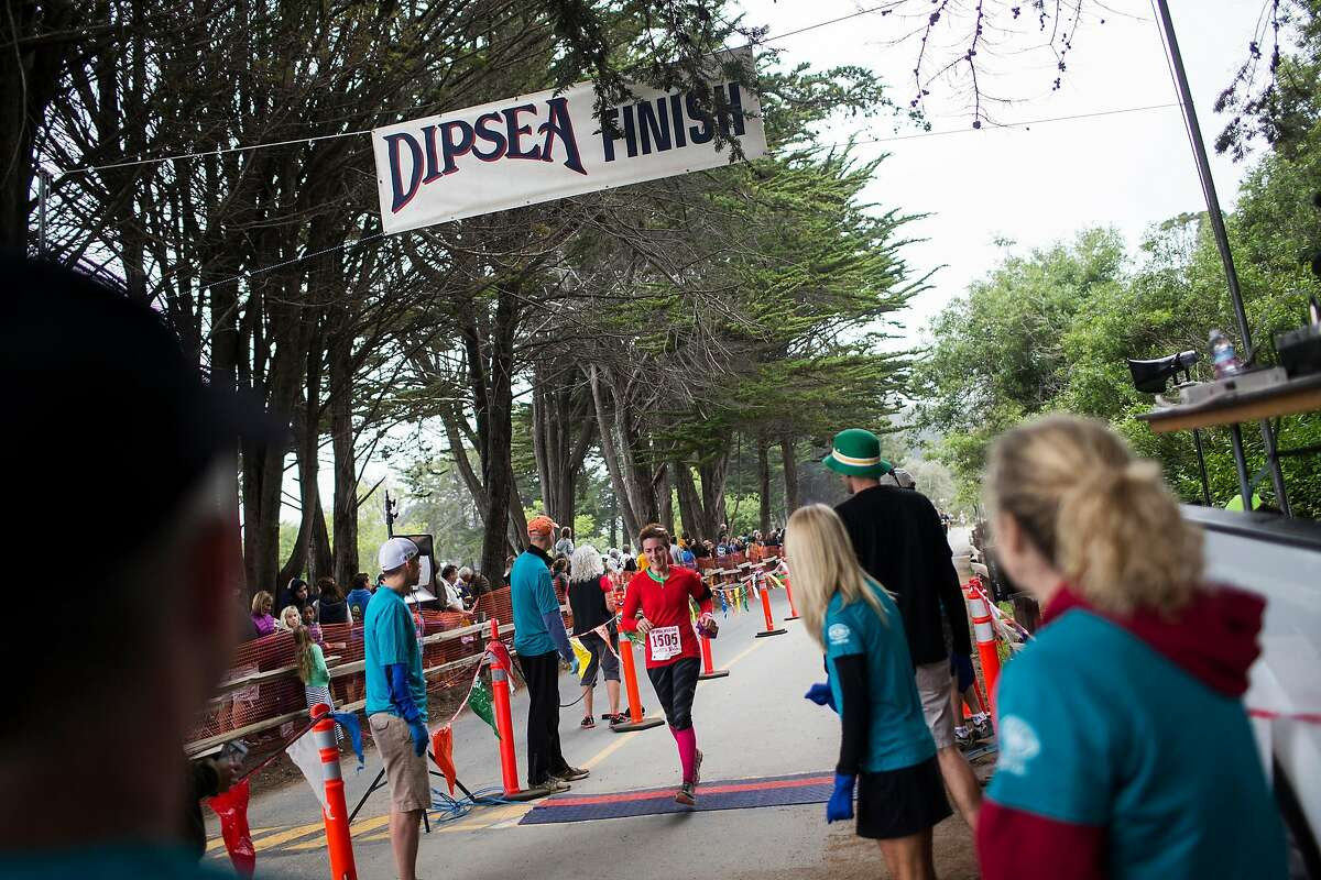 A runner crosses the finish line during the 105th annual Dipsea Race in Stinson Beach, Calif. on Sunday, June 14, 2015.