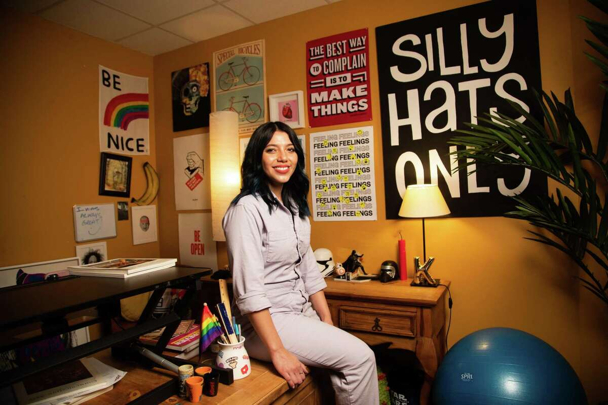 Lopez Negrete art director Karem García-Loera, 30, in her office, Friday, April 30, 2021, in Houston. García-Loera says that she has missed working closely in the same building with her colleagues.