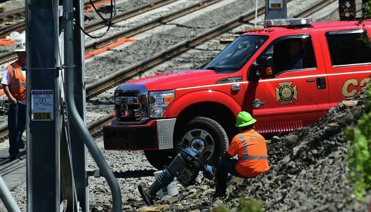 Emergency personnel and Metro North employees respond to the scene of a train accident Thursday May 6, 2021, in Norwalk, Conn.