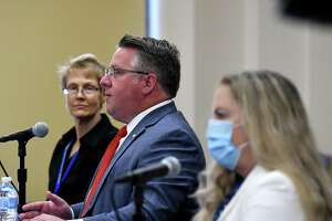 Albany County Executive Dan McCoy, center, is joined by Karen Ziegler, Director of the Albany County Crime Victim and Sexual Violence Center, left, and County Department of Health Commissioner Dr. Elizabeth Whalen, right, for a coronavirus news briefing on Friday, May 7, 2021, at the county offices in Albany, N.Y.  (Will Waldron/Times Union)