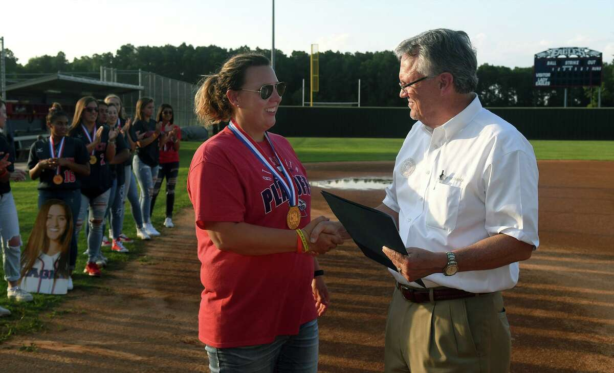 Atascocita Lady Eagles Head Softball Coach Ashley Boyd, left, receives a proclamation from Humble Mayor Pro-Tem Norman Funderburk officially congratulating the Lady Eagles on their winning the Class 6A State Softball Championship and designating June 6th, 2018, as