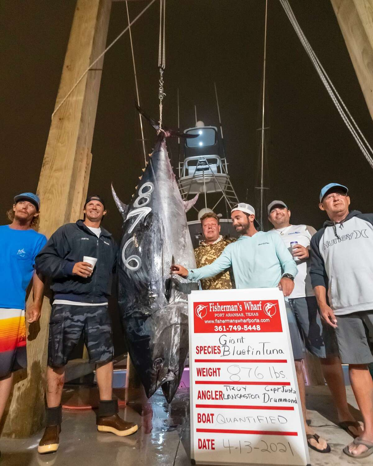 Angler Troy Lancaster reeled in an 876-pound, 10-foot bluefin tuna monster while out on a fishing trip with full-service marina and fishing service Fisherman's Wharf in Port Aransas on April 13.