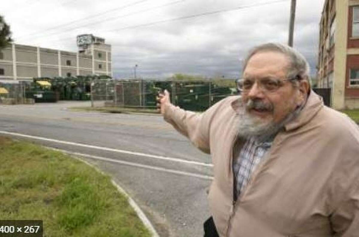 Albany South End resident Dominick Calsolaro points at waste bins at the Port of Albany where a trash hauler wanted to transfer household garbage onto semi-trailers.