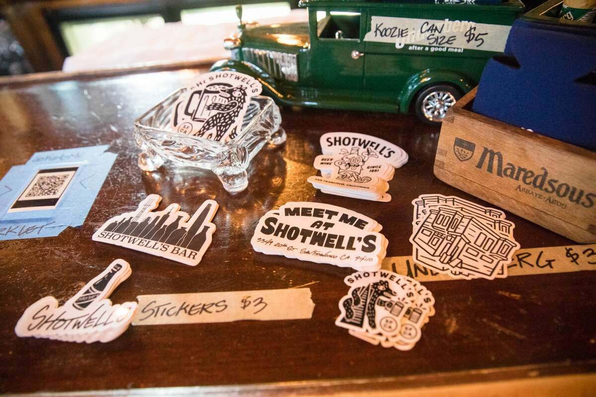 Stickers and other items that Shotwell's Saloon owners made to raise funds during the pandemic will go on sale at the San Francisco bar on May 6, 2021.  Guests were able to drink inside a bar for the first time since the bar began COVID-19 shutdowns in March 2020.