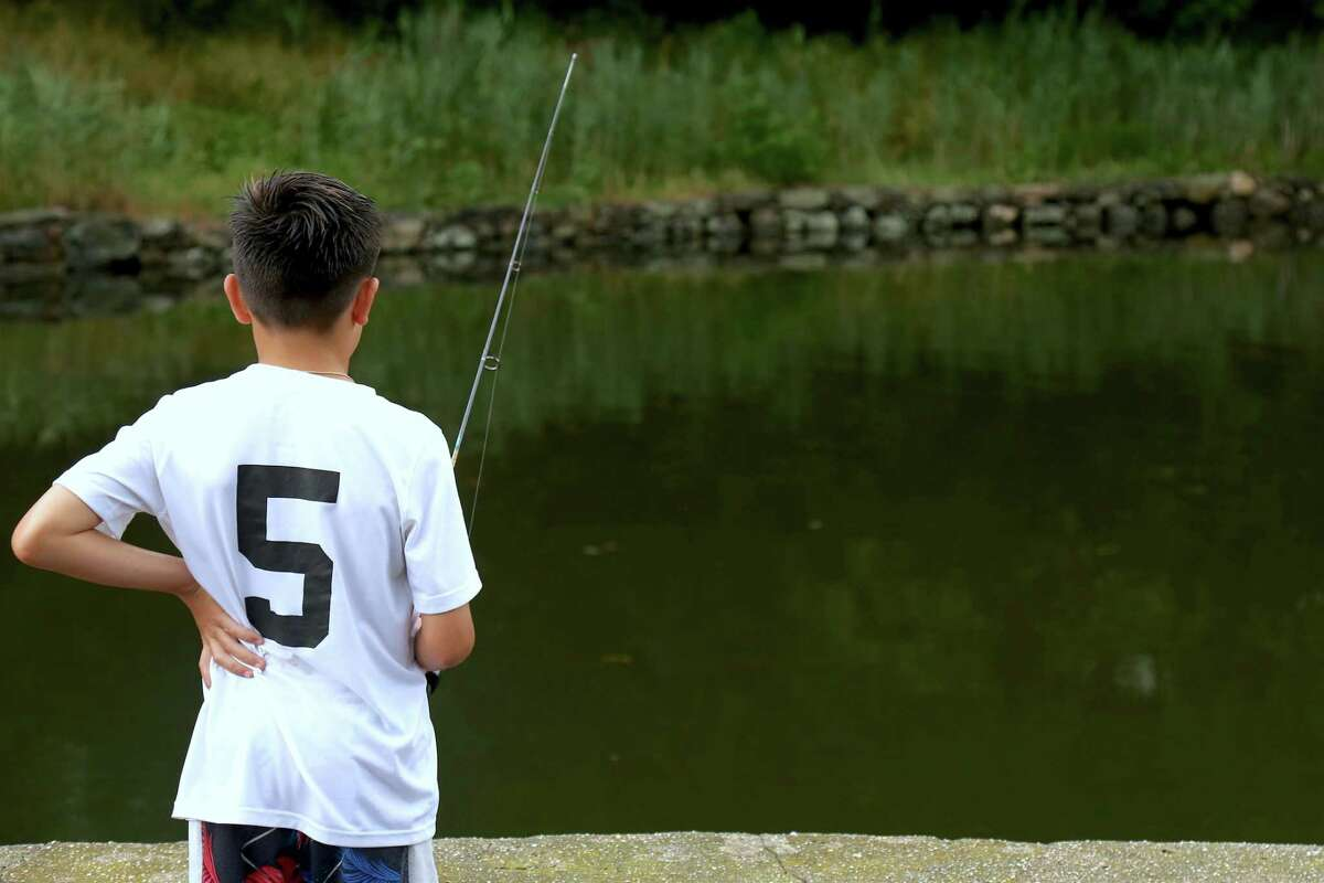 A file photo of a boy fishing off Harbor Road in Fairfield, Conn.