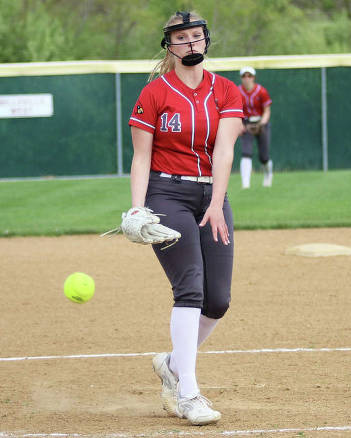 Alton's Alyson Haegele, shown pitching in a home game earlier this season, went the distance in the Redbirds' 2-1 SWC win over Belleville East on Thursday at Alton High in Godfrey.