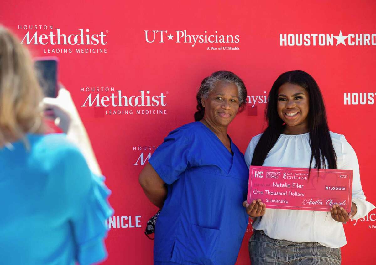 Lyndon B. Johnson Hospital nurse Lorintha Carr, left, takes a photograph with her granddaughter, Natalie Filer, at the Houston Chronicle's Salute To Nurses drive-thru event Thursday, May 6, 2021, in Houston. Filer, a University of St. Thomas junior, is a scholarship recipient.