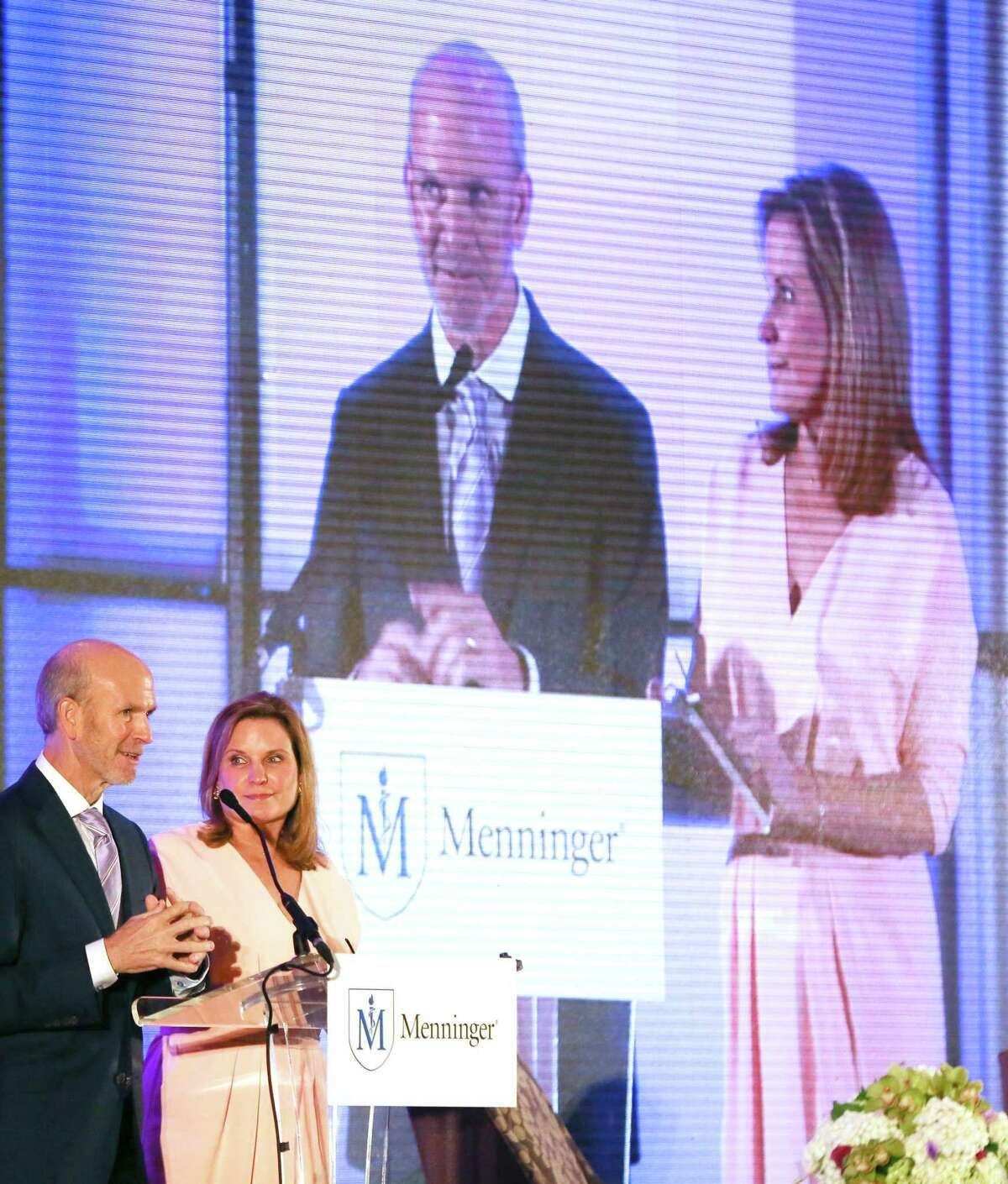 Luncheon chairs Michael and Stacy Ellington speak. The Menninger Clinic has seen a spike in mood disorders among those admitted during the pandemic.