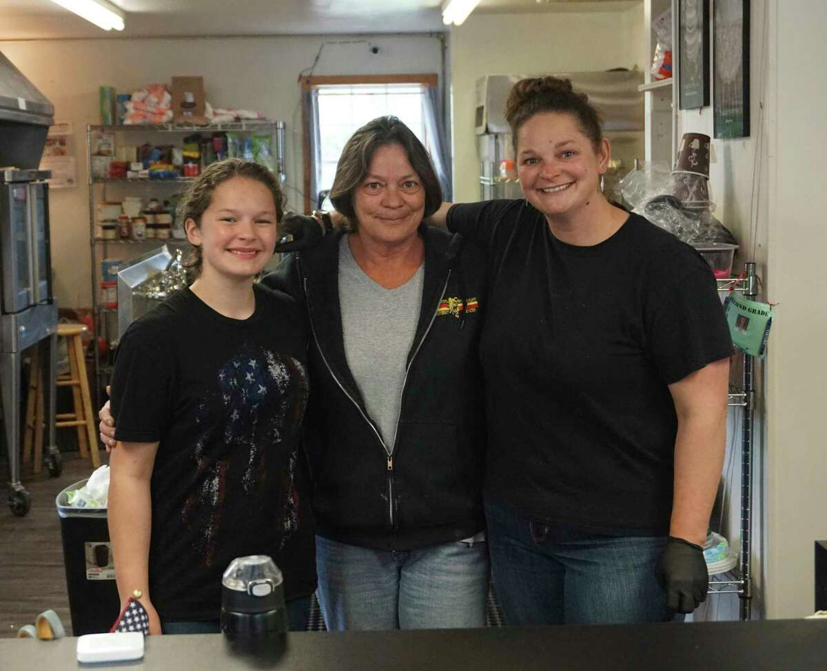 From left-to-right: Maddy Stricker, Doni Cassidy and Niki Stricker pose at the front counter of The Pie wHole. Recently, the business moved from Big Rapids to Paris. (Pioneer photo/Joe Judd)