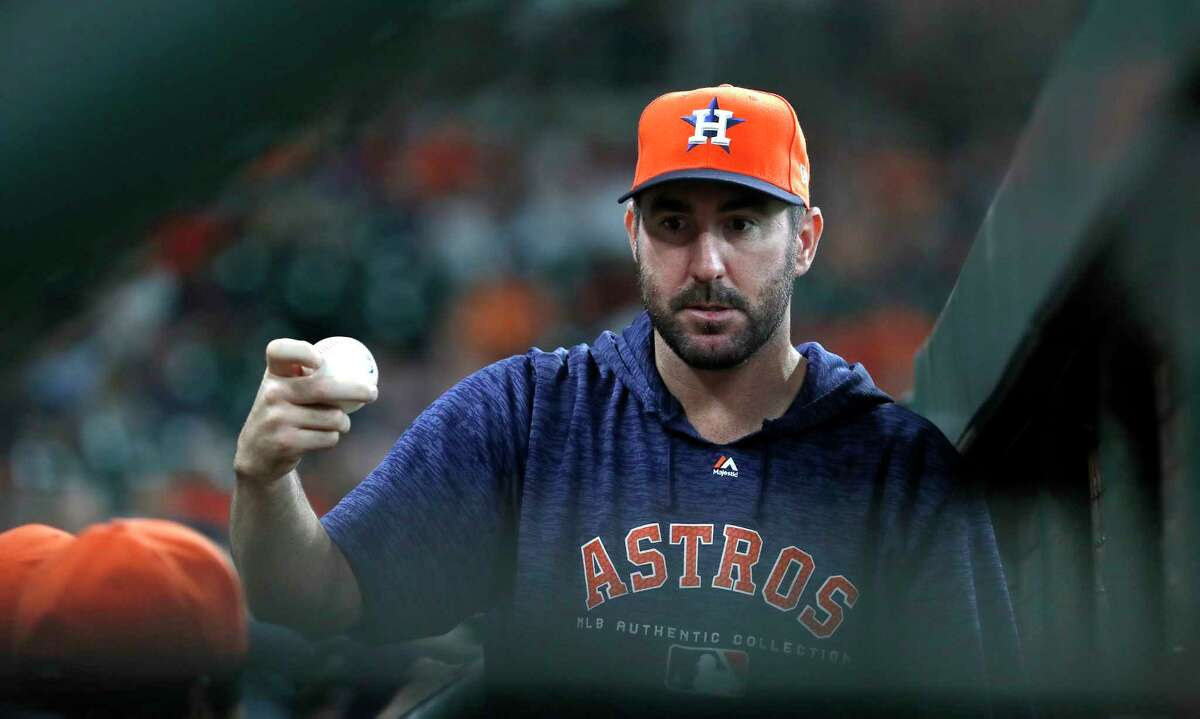 Houston Astros pitcher Justin Verlander in the dugout during the first inning of an MLB game at Minute Maid Park, Sunday, July 8, 2018, in Houston.