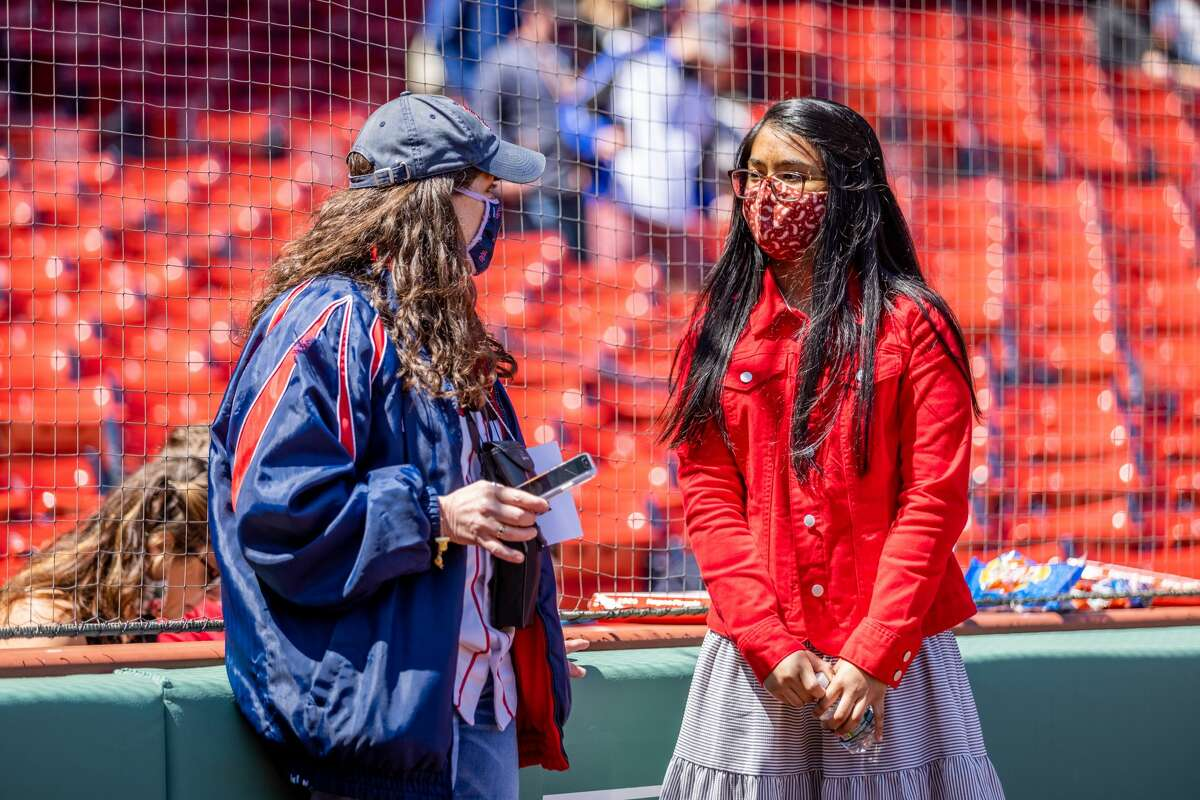 May 6, 2021, Boston, MA: Victoria Beniston talks with Fairfield Woods Middle School chorus teacher Carole Frawley prior to singing the national anthem before the Red Sox and Detroit Tigers game at Fenway Park in Boston, Massachusetts Thursday, May 6, 2021. (Photo by Nick Grace/Boston Red Sox)