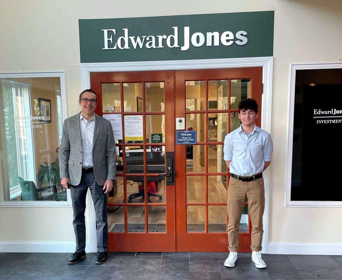 Westbrook High School student Zach Zanzalari, right, poses with his internship mentor Ryan Breen, left, at Edward Jones in Westbrook.