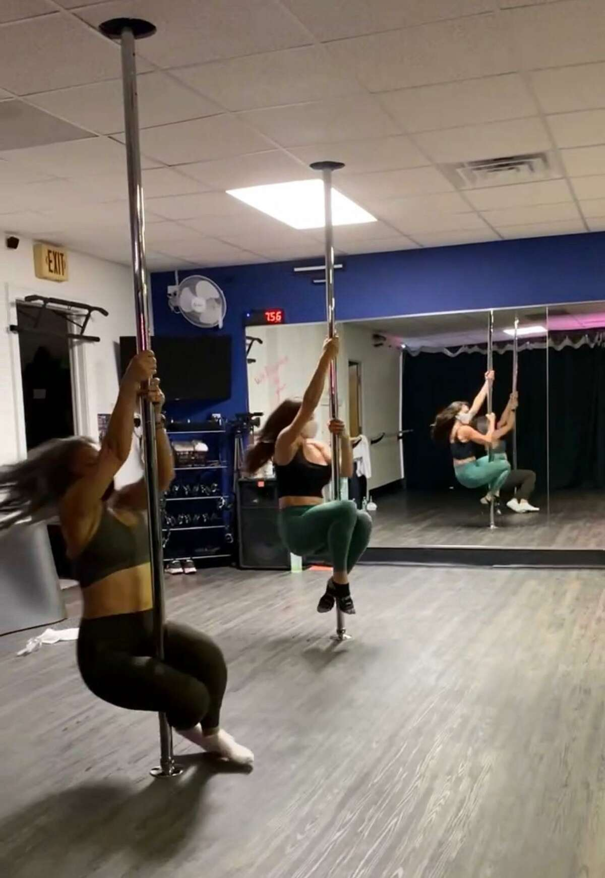 Yana Mayerman, left, and Naomi Collinge-Riek get a crash course in Intro to Pole at Affinity Studio in Ridgefield.